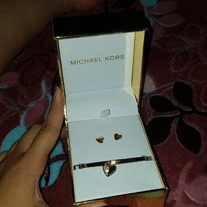 Micheal Kors gold heart bracelet and earrings